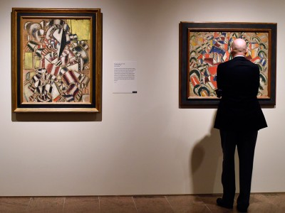 A man looks works by Fernand Léger during a press preview for