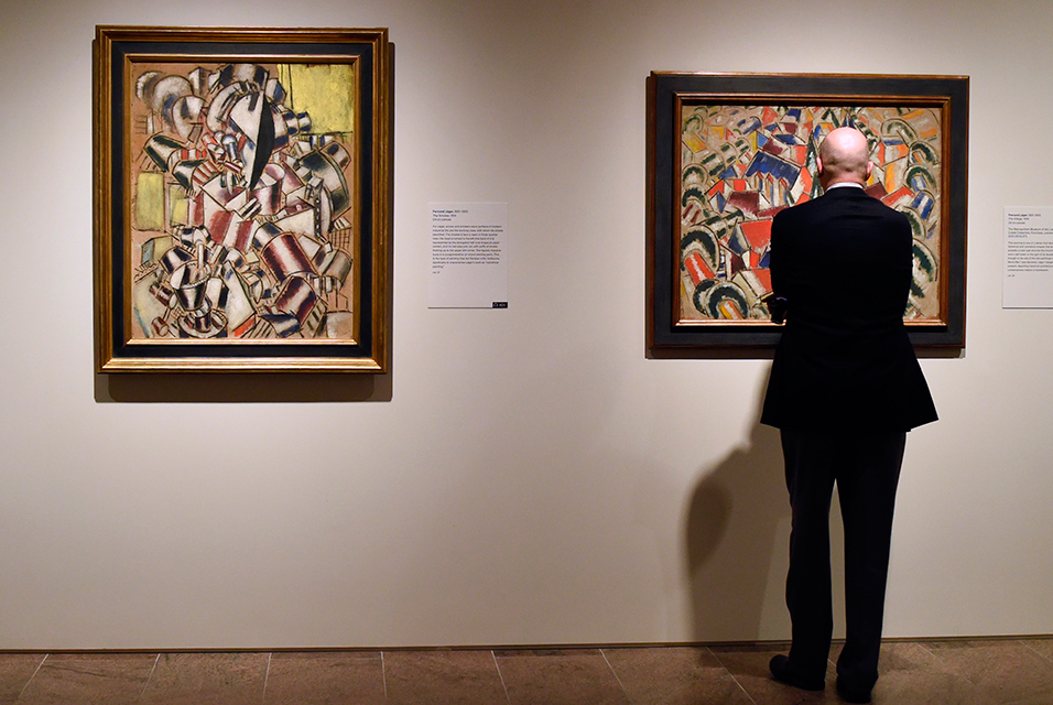 "A man looks works by Fernand Léger during a press preview for ""Cubism: The Leonard A. Lauder Collection "" a major exhibition of the essential Cubists—Georges Braque, Juan Gris, Fernand Léger, and Pablo Picasso at the The Metropolitan Museum of Art in New York Octover 14, 2014 The exhibition will mark the first time that the Collection is shown in its entirety. It features 81 paintings, works on paper, and sculpture: 17 by Braque, 15 by Gris, 15 by Léger, and 34 by Picasso AFP PHOTO / Timothy A. Clary."