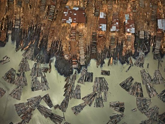 saw mills #1, lagos, nigeria, 2016 image by edward burtynsky   courtesy of metivier gallery, toronto